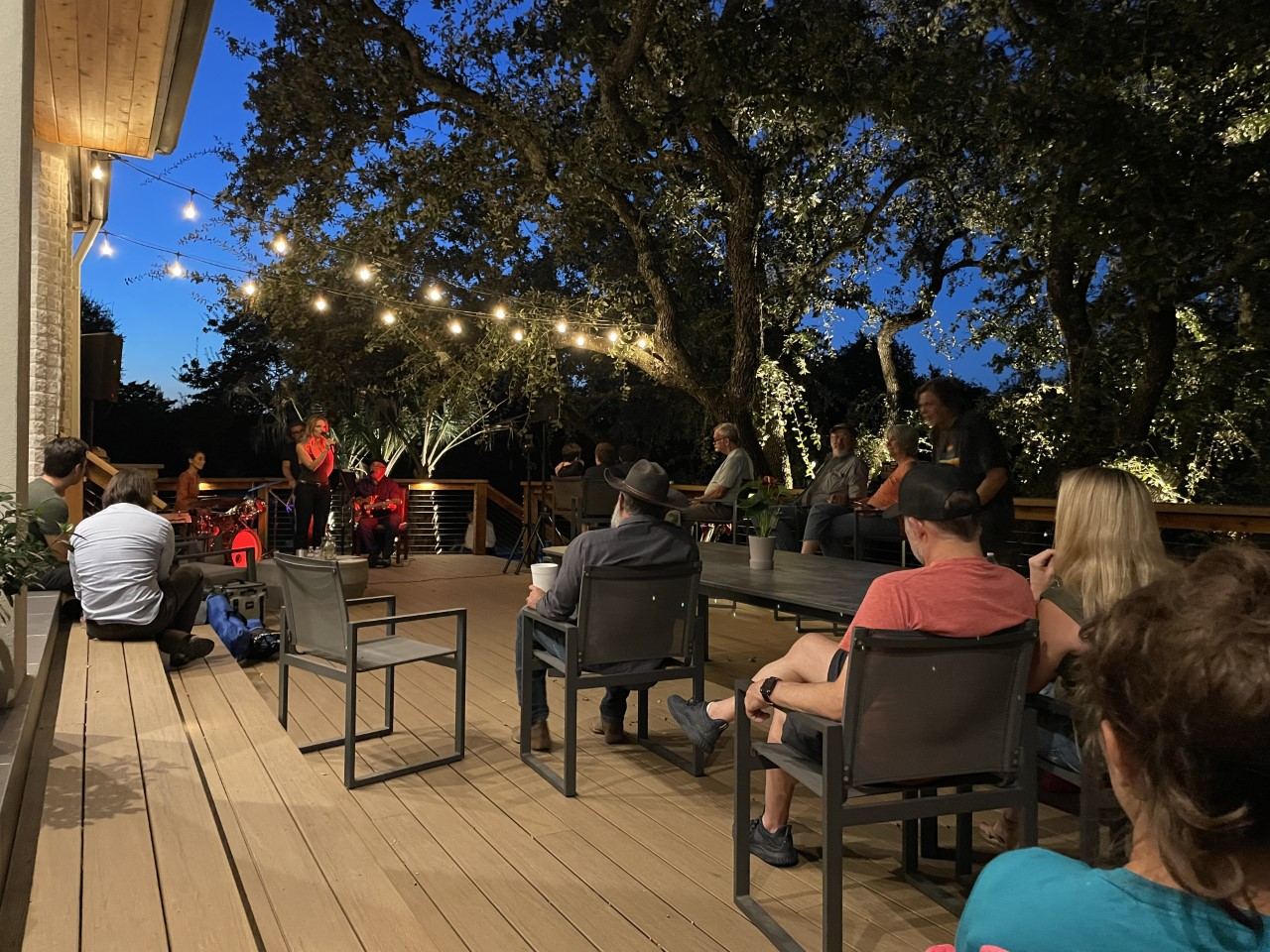 A band plays on a Bee Cave deck
