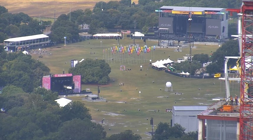 Puddles of water formed in Zilker Park after heavy rain swept soaked the ACL grounds overnight. Due to that, the start of ACL has been delayed three hours to 3 p.m. (KXAN photo)